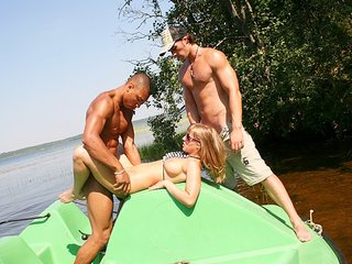 Boobed blonde  hard in a boat
